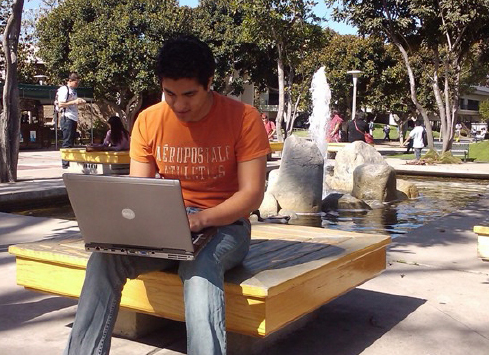 Student with Laptop on Campus