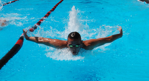 A SAC student-athlete swimming