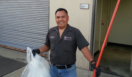 Custodial team member cleaning up the building.