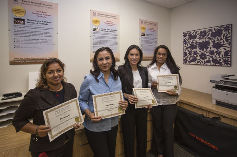 Students holding their Career Technical Edication State Approved Certificates.