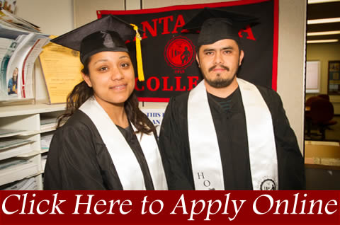 Two students wearing their graduation cap and gowns. Click here to apply online.