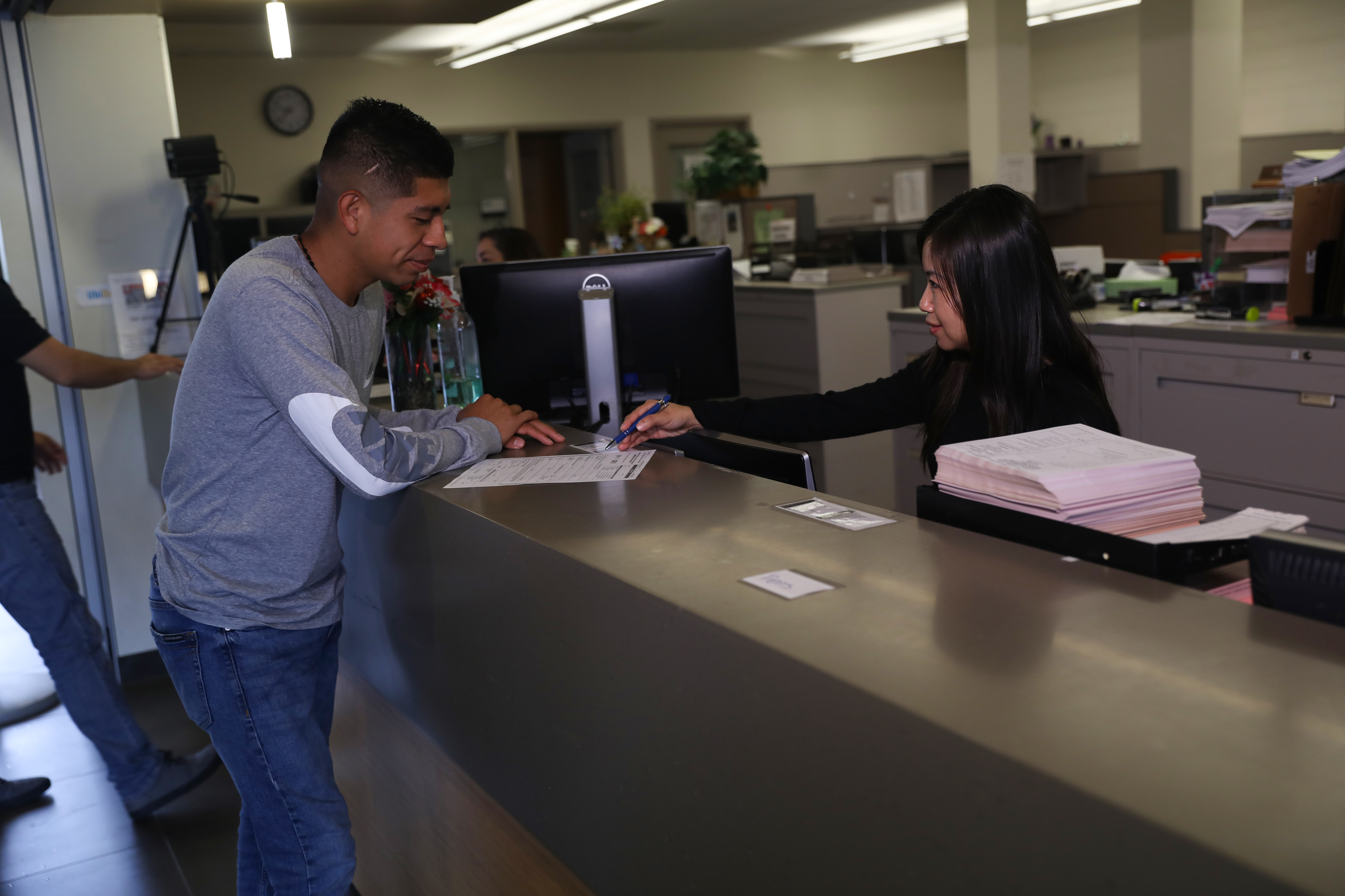 student being assisted by A&R staff at Admissions counter