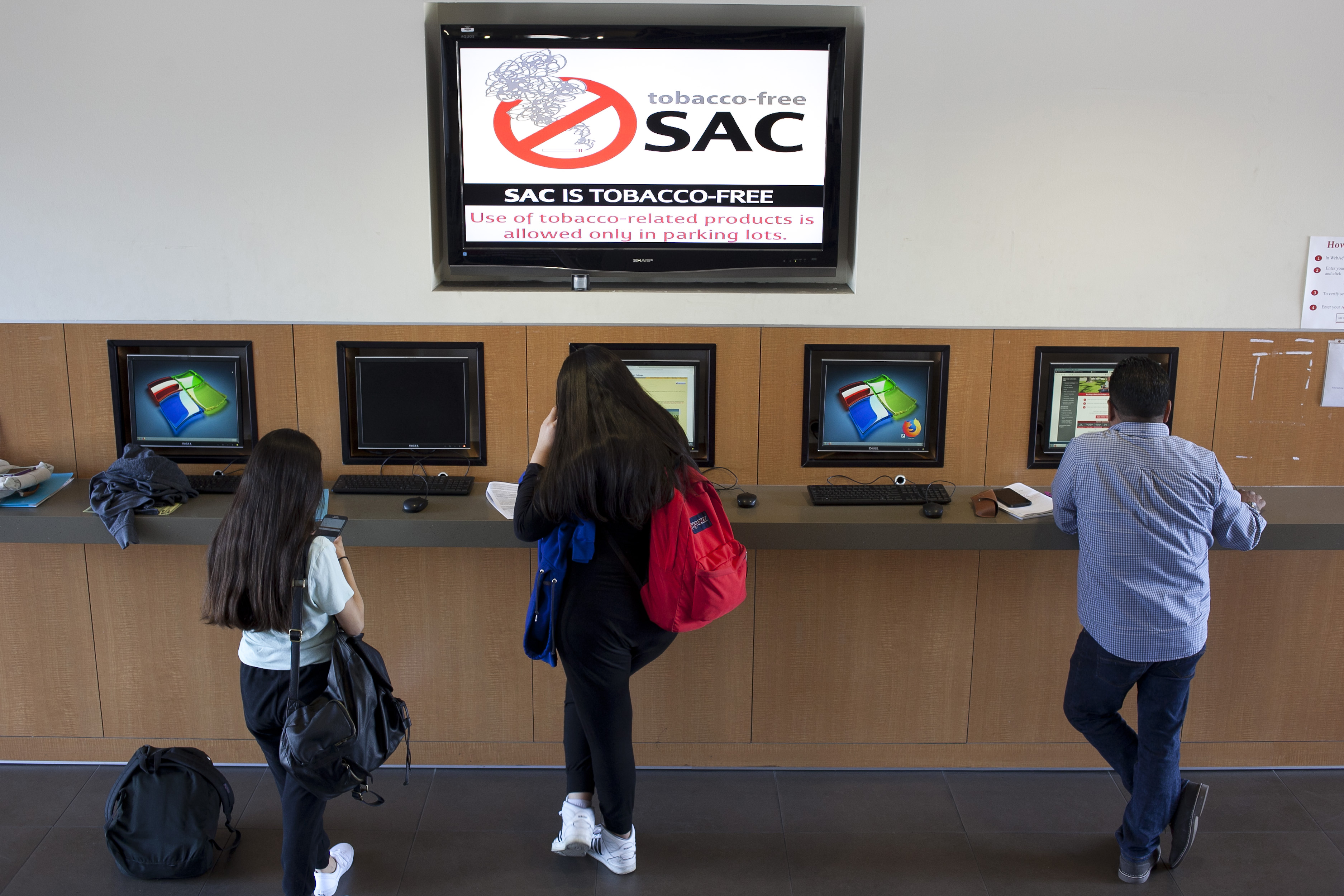 students using self service computer counter in Admissions lobby
